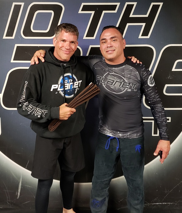Zach Waldman gets his Brown Belt from Eddie Bravo